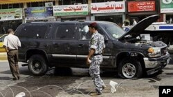Iraqi security forces inspect the scene of a roadside bomb in central Baghdad, Iraq, 26 Sep 2010.