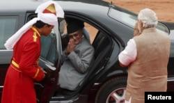 FILE - Nepal's Prime Minister Khadga Prasad Sharma Oli, center, greets his Indian counterpart, Narendra Modi, right, after his ceremonial reception at the forecourt of India's Rashtrapati Bhavan presidential palace in New Delhi, India, Feb. 20, 2016.