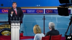 FILE - Republican presidential candidate, New Jersey Gov. Chris Christie responds to a question during the Republican presidential debate, Sept. 16, 2015. Christie has been removed from the next debate because of low polling numbers.