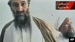 Al-Qaida leader Osama bin Laden is shown with top lieutenant, Ayman Al-Zawahri, in an image taken from a videotape broadcast on Al-Jazeera, October 2001. (file photo)