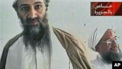 Al-Qaida leader Osama bin Laden is shown with top lieutenant, Ayman Al-Zawahri, in an image taken from a videotape broadcast on Al-Jazeera, October 2001. (file photo)