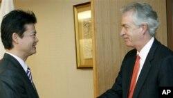 U.S. Deputy Secretary of State William Burns, right, shakes hands with Japan's Foreign Minister Koichiro Gemba, prior to their meeting in Tokyo, Monday, Oct. 15, 2012. (AP Photo/Koji Sasahara)