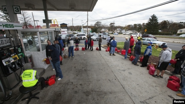 People affected by the power outages from Hurricane Sandy wait in line at a gas station to purchase fuel for generators in Madison Park, New Jersey, October 31, 2012.