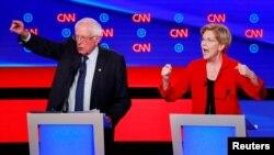 U.S. Senator Bernie Sanders and U.S. Senator Elizabeth Warren speak on the first night of the second 2020 Democratic U.S. presidential debate in Detroit, Michigan, U.S., July 30, 2019.