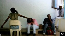 FILE - HIV patients wait to receive their anti-retroviral medicine at the Deborah Retief hospital in Moshundi, Botswana, Thursday, Nov. 17, 2005.