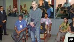 Dutch citizen Joran Van der Sloot stands in front of a judge during his trial at the Lurigancho prison in Lima, Peru, January 6, 2012.