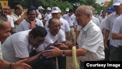 FILE: Prince Norodom Ranariddh, president of FUNCINPEC, is greeted by his supporters during an election campaign in Kampong Cham province on May 20, 2017. (Courtesy photo from a local journalist)