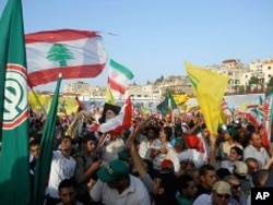 Tens of thousands of people turned out in support of the Iranian president in southern Lebanon and waved flags of Iran, Lebanon, Hezbollah and Amel, a Hezbollah-allied Shi'ite party.
