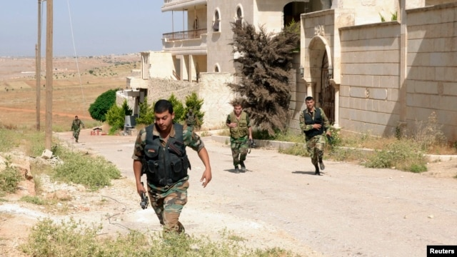 Forces loyal to Syria's President Bashar al-Assad are on the move June 3, 2013, in what the government said was an operation against rebels in the Aleppo countryside.