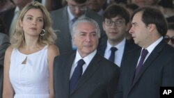 Brazil's President Michel Temer, center, and wife Marcela Temer, watch an Independence Day military parade in Brasilia, Brazil, Sept. 7, 2016. Pictured right is Lower House Speaker Rodrigo Maia.
