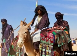 Tuaregs ride on camels during a festival in Iferouane, Niger, Feb. 17, 2018.