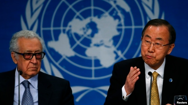 U.N. Secretary-General Ban Ki-moon sits beside U.N.-Arab League envoy for Syria Lakhdar Brahimi (L) as he addresses a news conference after the Geneva-2 peace talks in Montreux on January 22, 2014.