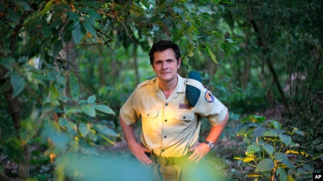 In this file photo taken on Wednesday, Aug. 11,  2012,  Emmanuel de Merode, Virunga National Park director and chief warden, poses at the park headquarters in Rumangabo. The Belgian director of Africa's oldest national parkwas shot and seriously wounded by three. unknown assailants on Tuesday, April 15. He was traveling between Goma, a main city in the east near Rwanda's border, and Rumangabo at the time. (AP Photo/Jerome Delay,File)