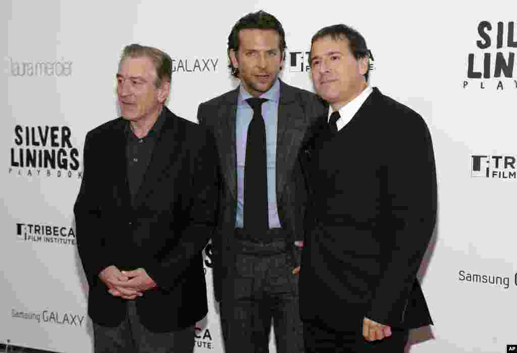 "Actors Robert DeNiro, left, Bradley Cooper, and Director David O. Russell, right, attend the premiere of ""Silver Linings Playbook,"" at the Ziegfeld Theatre in New York, November 12, 2012."