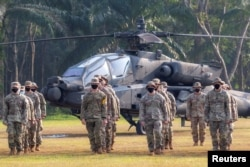 Tentara Angkatan Darat AS ambil bagian dalam pembukaan Latihan MIliter Gabungan Garuda Shield 2021 di Pusat Pelatihan Tempur Angkatan Darat Indonesia di Baturaja, provinsi Sumatera Selatan, 4 Agustus 2021. (Antara Foto/Nova Wahyudi/via Reuters)
