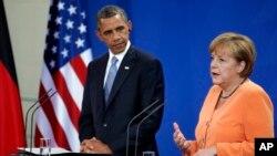 Presiden AS Barack Obama bersama Kanselir Jerman Angela Merkel dalam sebuah konferensi pers di Berlin, Juni 2013.