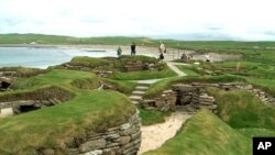 Visitors look at the 5,000 year-old remains of Skara Brae village in the Scottish Orkney Islands, July 19, 2005. ( AP Photo/Naomi Koppel)