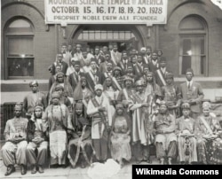 Attendees of the 1928 Moorish Science Temple Conclave in Chicago. Noble Drew Ali is in white in the front row center.
