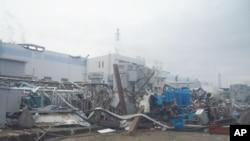 ຮູບໂຮງໄຟຟ້ານີວເຄລຍ Fukushima Daiichi ໃນແຂວງ Fukushima ທີ່ໄດ້ຮັບຄວາມເສຍຫາຍ ວັນທີ 14 ເມສາ 2011