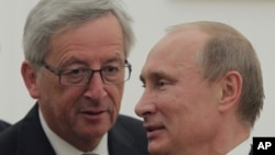 Премьер-министр Люксембурга Жан-Клод Юнкер и Президент России Владимир Путин