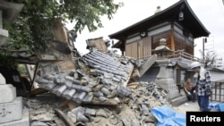 Damaged Myotoku-ji temple caused by an earthquake is seen in Ibaraki, Osaka prefecture, western Japan, in this photo taken by Kyodo June 18, 2018. Kyodo via REUTERS