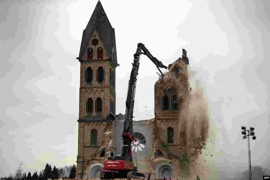 The desacralized St. Lambertus church in Erkelenz-Immerath, Germany, is being demolished in order to make possible brown coal surface mining. Residents from the village of Immerath were relocated, as the area is to be developed by German energy supplier RWE Power in an extension of its Tagebau Garzweiler open-pit lignite mine.