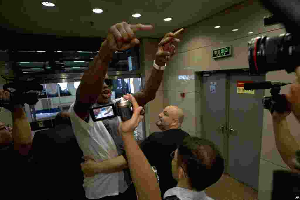 Dennis Rodman gestures as he reacts to a question about American citizen Kenneth Bae who remains imprisoned in North Korea, at Beijing Capital International Airport, Sept. 7, 2013.
