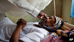 FILE - A patient with hepatitis is treated at a hospital in El Sereif village, North Darfur, Sudan, May 13, 2013.