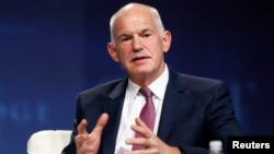 FILE - George Papandreou, former Greek prime minister, speaks at a panel discussion Las Vegas.