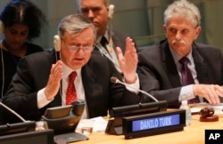 General Assembly President Mogens Lykketoft, right, listens as former Slovenian President Danilo Turk, left, address questions from the 193-member General Assembly about his candidacy for U.N. Secretary General, April 13, 2016 at U.N. headquarters.