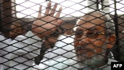 FILE - Egyptian Muslim Brotherhood's general guide , Mohamed Badie at the trial of Brotherhood members in February, 2014 near Cairo's Turah prison.