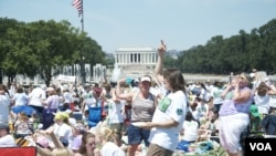 Tens of thousands of young people on the National Mall celebrate the 100th anniversary of Girl Scouts of the United States