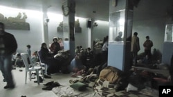 Residents rest in a shelter in is Baba Amr near Homs, February 8, 2012. Syrian forces thrusting into the rebellious city of Homs, killing dozens of civilians.