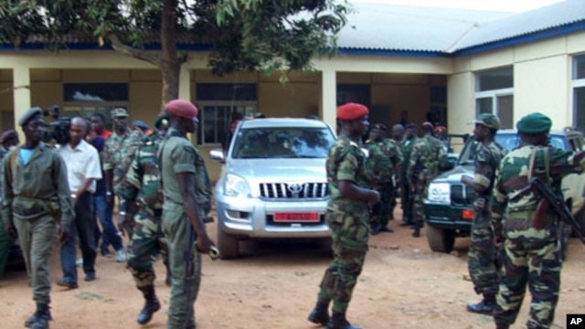 Military soldiers of Guinea-Bissau leave a building on April 13, 2012 after a meeting in Bissau.