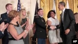 FILE - President Barack Obama greets members of the military and their families at the White House after the launch of Joining Forces, a national initiative to support service members and their families through job, wellness and educational opportunities,