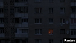 A single light illuminates a room Nov. 24, 2015, during a blackout at a residential building in Simferopol, Crimea. Crimea continued to rely on emergency generators to meet its basic power needs.