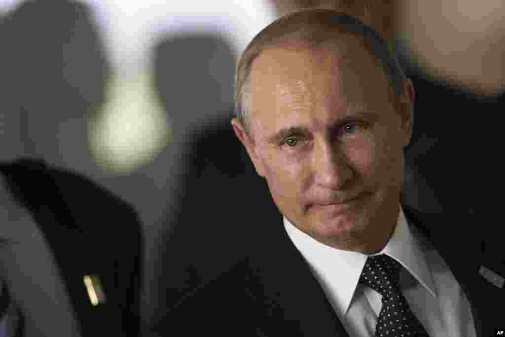 President Vladimir Putin: ``This tragedy would not have happened if there had been peace on that land, or in any case if military operations in southeastern Ukraine had not been renewed. And without doubt, the government of the territory on which it happened bears responsibility for this frightening tragedy. We will do everything that we can so that an objective picture of what happened can be achieved. This is a completely unacceptable thing.''