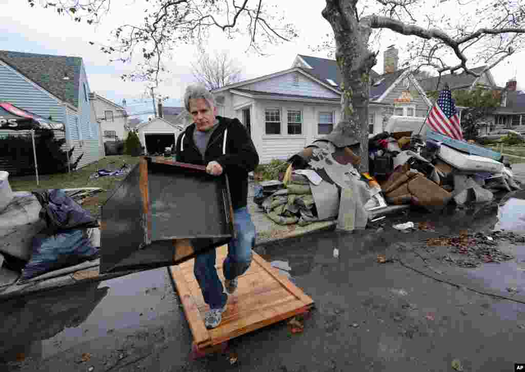 Dave Skudin empties his home of household items that were destroyed by flooding from Superstorm Sandy on Nov 1, 2012, in Long Beach, N.Y.
