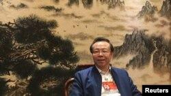 2017年3月7日在北京举行全国人大会议期间,中国华融资产管理有限公司董事长赖小民接受路透社采访。