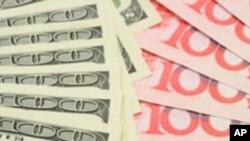 Closeup of fanned US dollar and China yuan bills