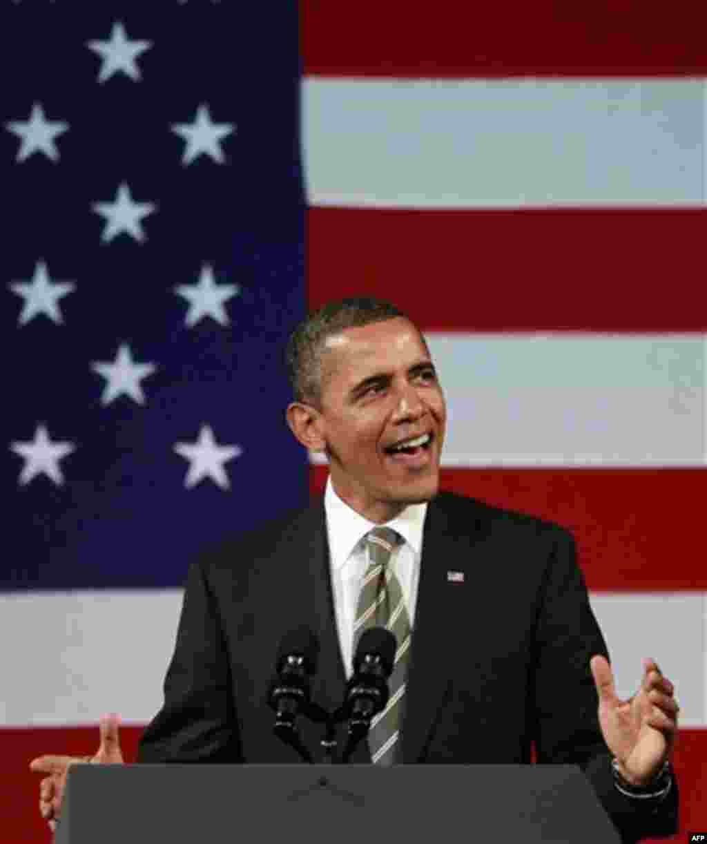 President Barack Obama sings before speaking at a campaign event, Thursday, Jan. 19, 2012, at the Apollo Theatre in the Harlem neighborhood of New York. (AP Photo/Haraz N. Ghanbari)