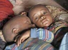 Twins Sao and Jinna at home in Kailahun, Sierra Leone. Several of their siblings were stillborn or died in infancy