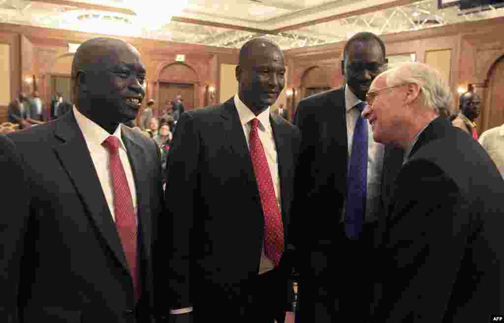 Members of South Sudan's rebel delegation talk with US Envoy to Sudan and South Sudan Donald E. Booth (R) on Jan. 4, 2014 during talks in Addis Ababa to try to broker a ceasefire deal between government and rebel forces.