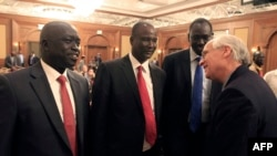 Members of South Sudan's rebel delegation talk with US Envoy to Sudan and South Sudan Donald E. Booth (R) on Jan. 4, 2014 during talks in Addis Ababa to try to broker a ceasefire between government and opposition forces.