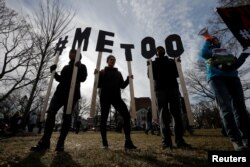 "Demonstrators spell out ""#MeToo"" during the local second annual Women's March in Cambridge, Mass., Jan. 20, 2018."