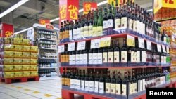 Shelves displaying discounted wines are seen at a supermarket in Shanghai, China, Oct. 29, 2015.