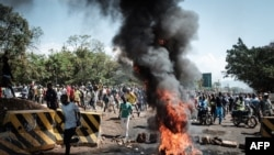 Opposition supporters block streets and burn tires during a protest in Kisumu, Kenya, on Oct. 11, 2017. Supporters of Kenya's opposition leader Raila Odinga took to the streets as poll officials mull their next move after his withdrawal from an upcoming presidential election.