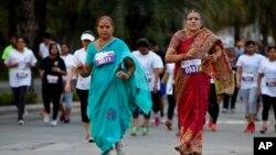 Традиционный пятикилометроый марш в Индии в честь Международного женского дня