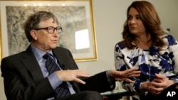 FILE - Bill and Melinda Gates talk to reporters about the 2016 annual letter from their foundation, the Bill and Melinda Gates Foundation, in New York, Feb. 22, 2016. Researchers are trying to infect mosquitoes in Brazil and Colombia with a type of bacteria that could prevent them from spreading Zika virus and other dangerous diseases.