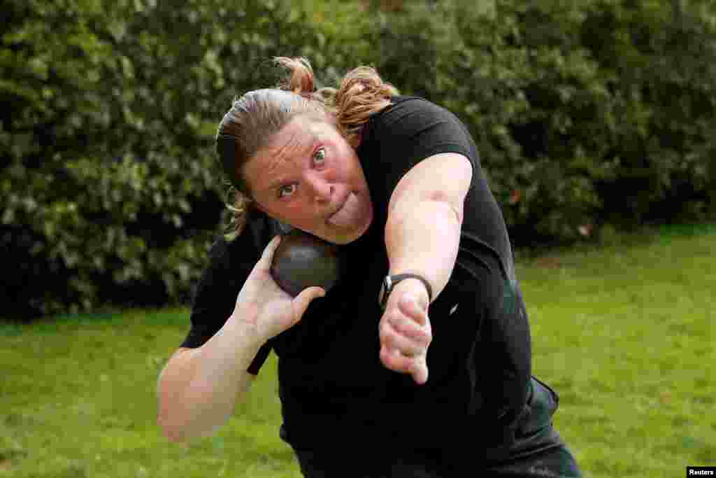 Team GB Shot Putter, Sophie McKinna, trains in her garden following the coronavirus disease (COVID-19) outbreak, in Lound, Britain.